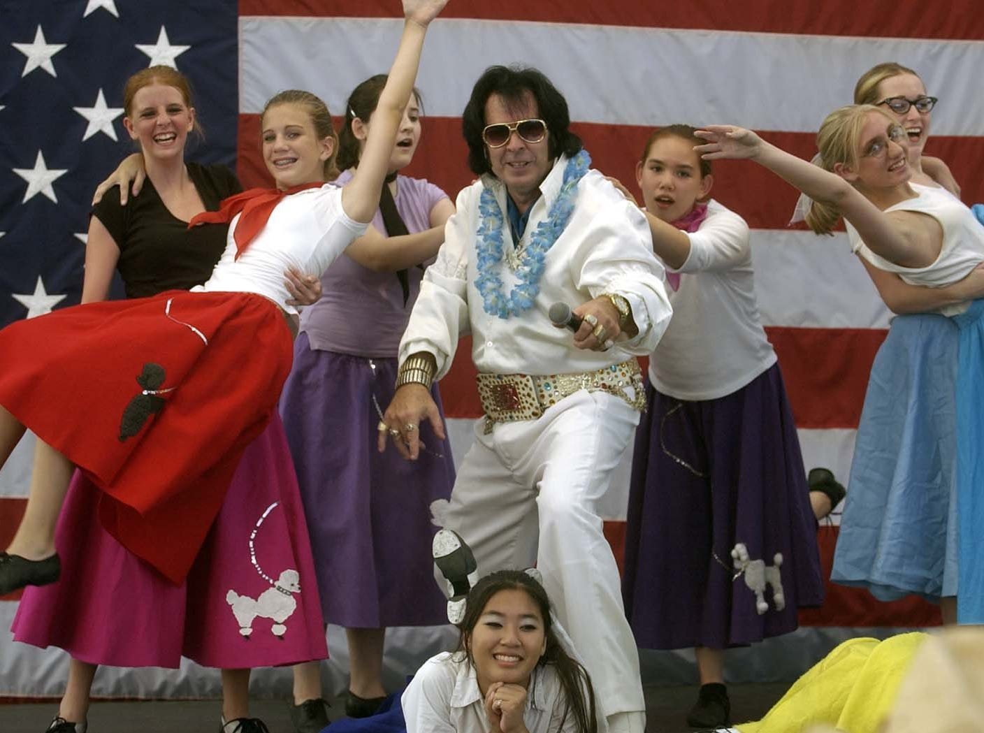 Otis Berry (aka Elvis) sings as the Diane Moore Dancer perform the last day of the Kentucky State Fair in Louisville, Ky.