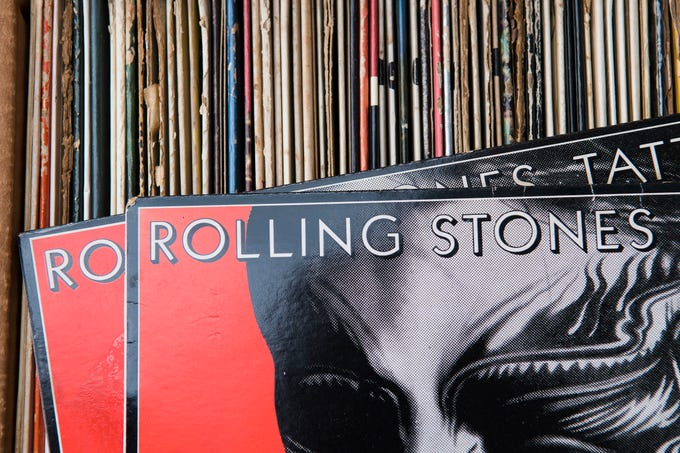 Two Rolling Stones albums rest on a box full of vinyl records among Bill Barriger's recent haul of nearly 300,000 vinyl records on August 1, 2018.