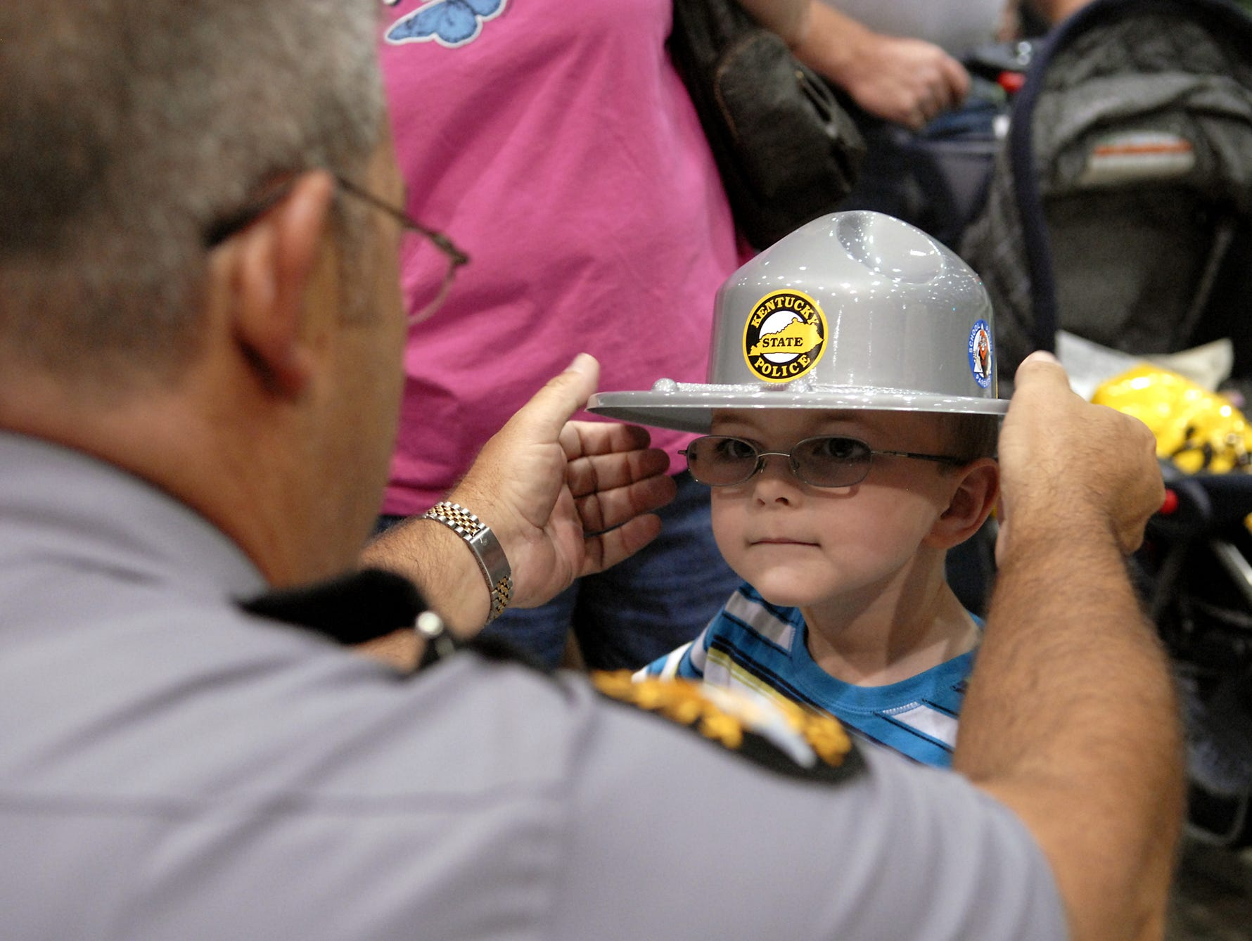 Trooper Chip Perry handed out a replica of the Kentucky State Police hat to Cameron Williamson, 4.
