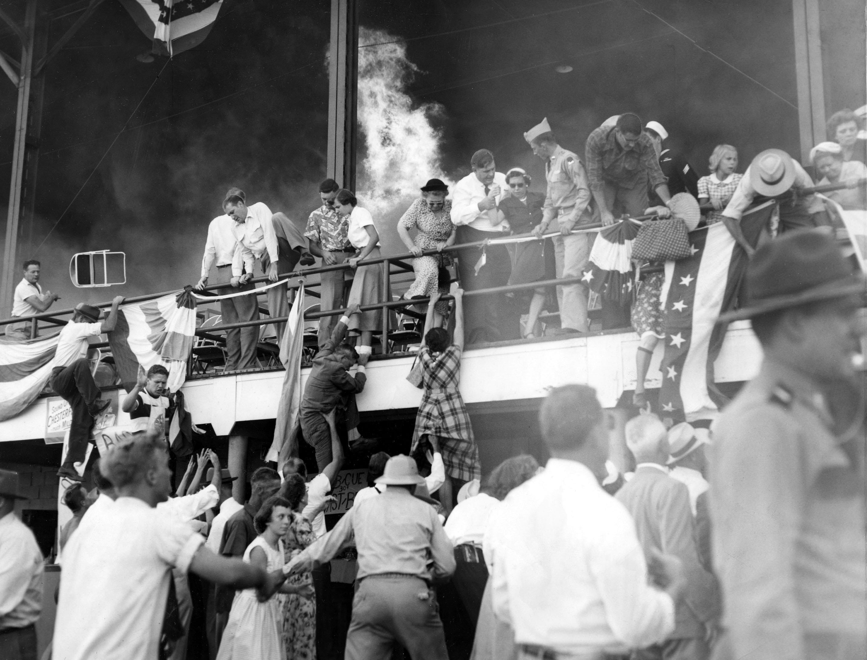 FIRE CAME to the Kentucky State Fairgrounds in 1952. This was the scene on September 11 when the grandstand caught fire as 3,000 spectators waited for a water show to begin. No one was seriously injured. Damage was estimated at $70,000 to $80,000. The fire was believed caused by a cigarette wedged between timbers.