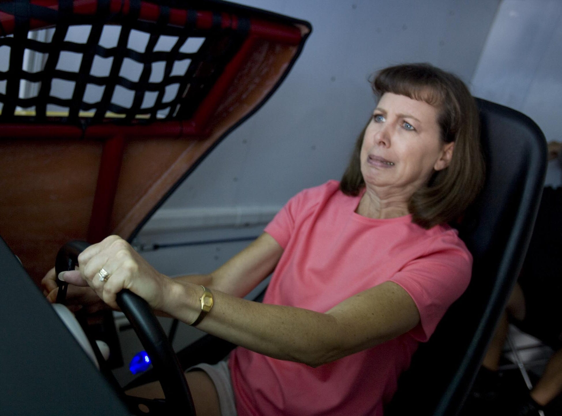"""I swear I don't drive like this on the road,"" joked Donna Ferrill of Fairdale as she grimaced while driving in the Toyota NASCAR simulator Sunday at the Kentucky State Fair."