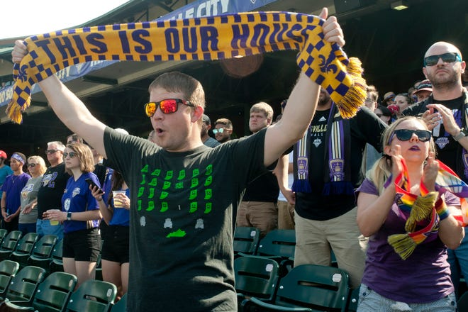 """Joe Young of Strathmoor Gardens holds up a """"This is our House"""" banner in support of his team, Louisville City FC in their game against Indianapolis. August 05, 2018"""
