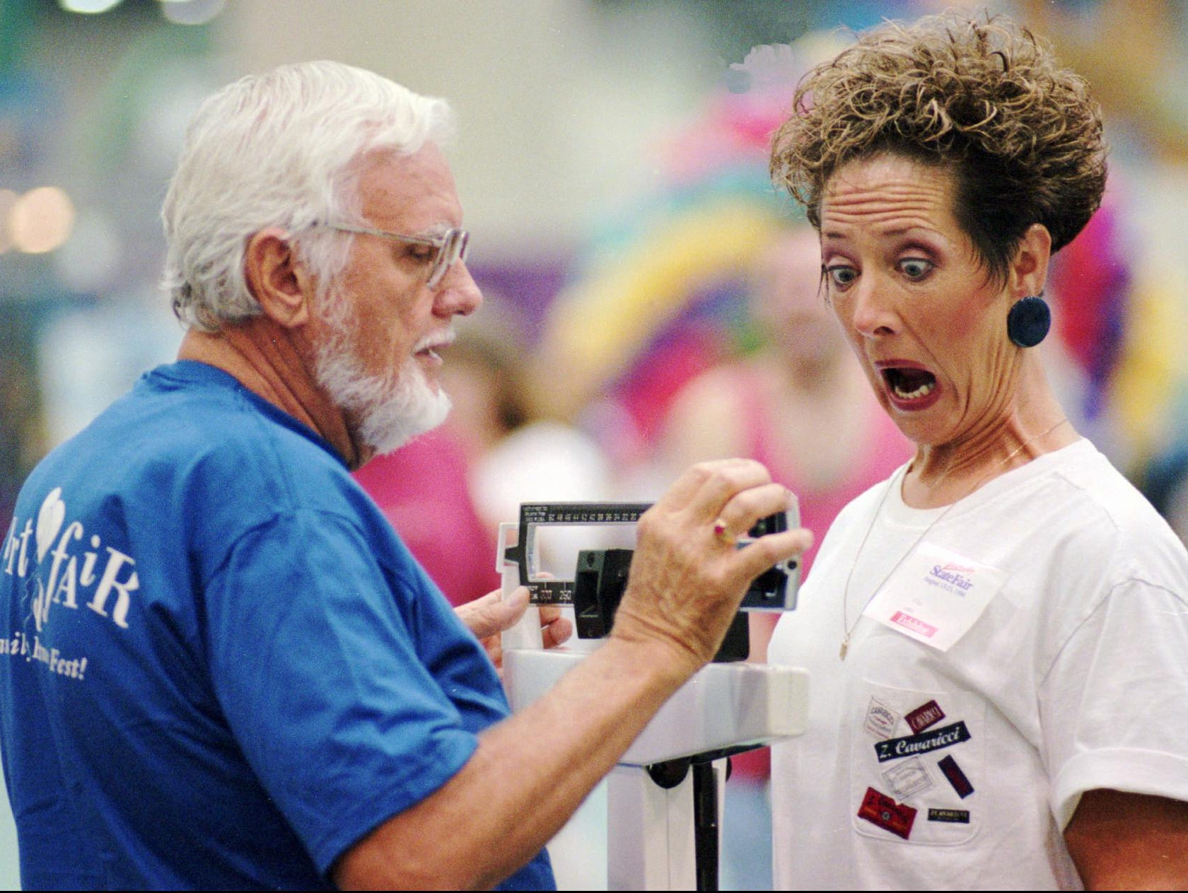 Karen Price reacted as Mike Willman took her weight at the Kentucky State Fair last week. Price, of Clearfield, Utah, was having a fitness checkup at a heart-health booth sponsored by Jewish Hospital HealthCare Services. Willman, who participates in the hospital's cardiac rehab program, also volunteers there three days a week. For the fair, he was among 1,111 volunteers from the community recruited to operate the booth. Volunteers included hospital employees, Black Achievers and employees of BellSouth, General Electric, Providian and United Distillers. Hospital officials said Monday that 39,000 people received free checkups during the 11-day fair.-