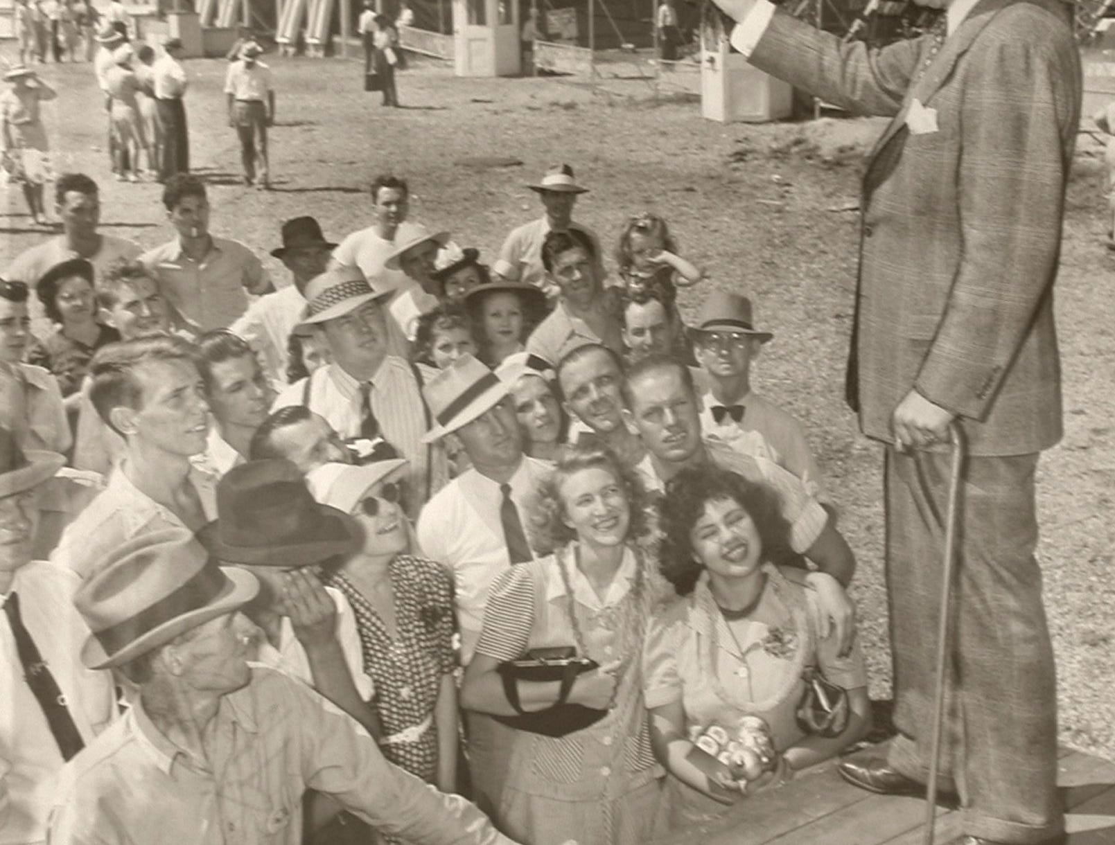 A small gathering listened to the spiel of barker Duke Drukenbrod at the Kentucky State Fair in September of 1941.