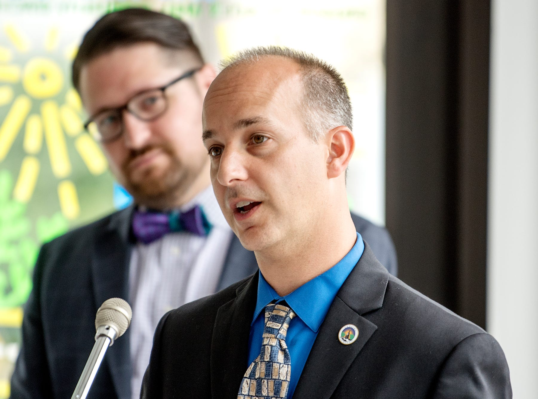 Mayor Andy Schor, right, speaks during a press conference kicking off 'Imagine the Avenue' on Monday, Aug. 6, 2018, at The Venue on Michigan Avenue in Lansing. CATA chairperson Nathan Triplett, left, looks on.