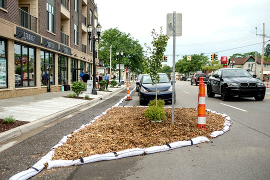 Temporary landscaping is in place as part of 'Imagine the Avenue' on Monday, Aug. 6, 2018, at The Venue on Michigan Avenue in Lansing.