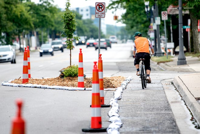 A bicyclist makes his way down a temporary bike lane on Monday, Aug. 6, 2018.