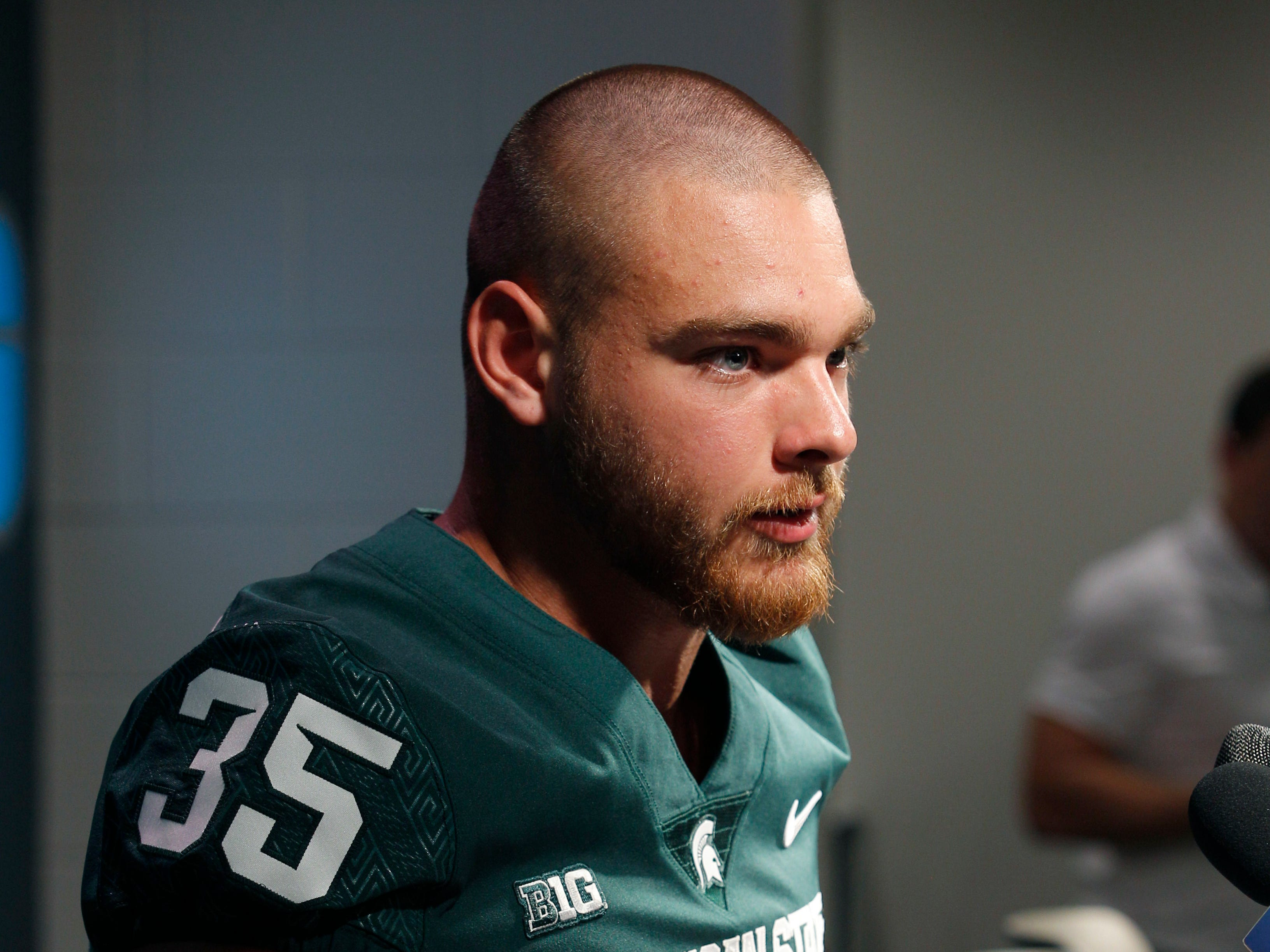 Michigan State linebacker Joe Bachie talks with reporters during the team's NCAA college football media day, Monday, Aug. 6, 2018, in East Lansing, Mich.