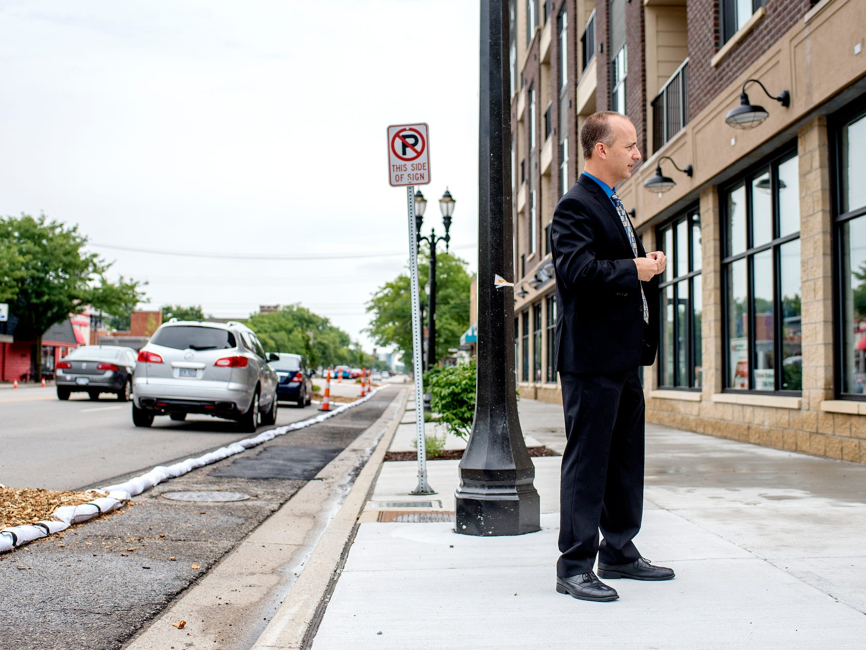 Mayor Andy Schor stands on Michigan Avenue after a press conference kicking off 'Imagine the Avenue' on Monday, Aug. 6, 2018, at The Venue in Lansing.