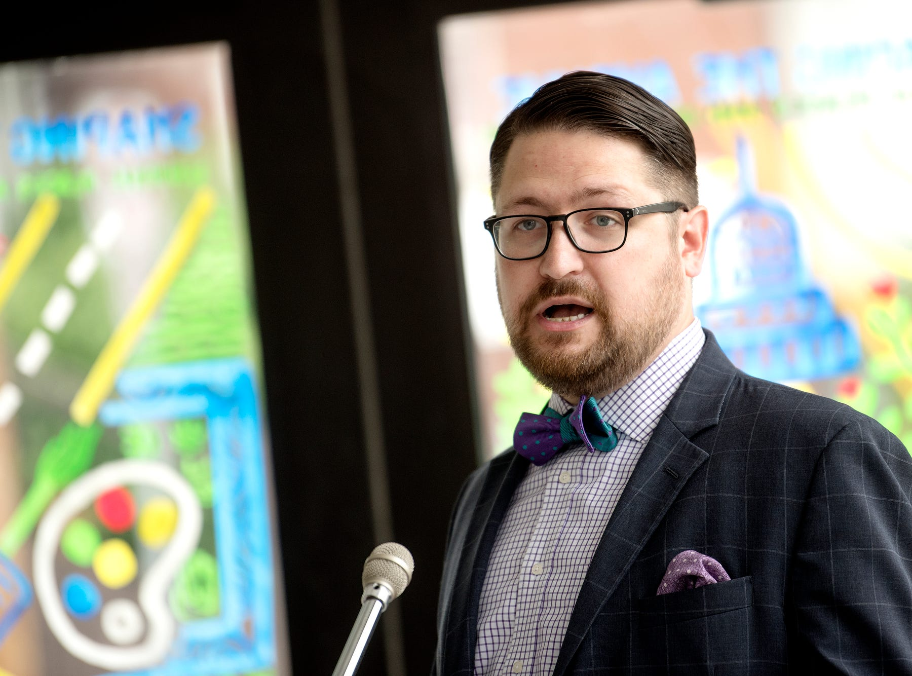 CATA chairperson Nathan Triplett speaks during a press conference kicking off 'Imagine the Avenue' on Monday, Aug. 6, 2018, at The Venue on Michigan Avenue in Lansing.