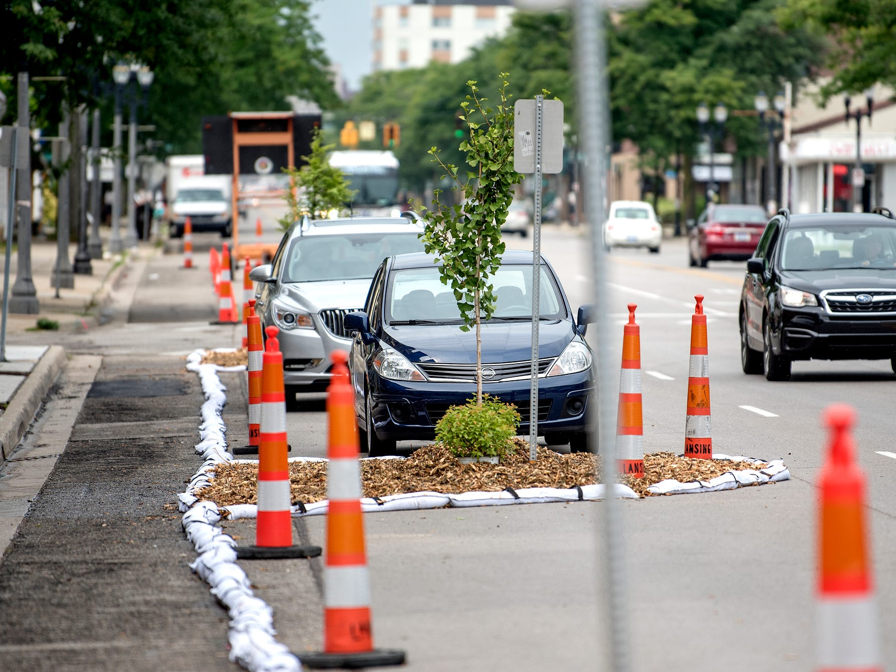 Temporary bike lanes and landscaping in place as part of 'Imagine the Avenue' on Monday, Aug. 6, 2018, at The Venue on Michigan Avenue in Lansing. From Aug. 6-11, the 2000 block of Michigan Avenue will be displaying temporary street design changes including protected bike lanes, expanded sidewalks and enhanced bus stops.