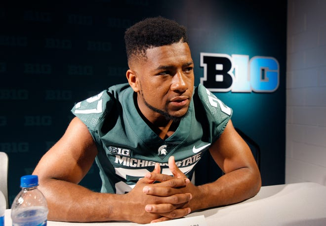 Michigan State safety Khari Willis talks with reporters during the team's NCAA college football media day, Monday, Aug. 6, 2018, in East Lansing, Mich.
