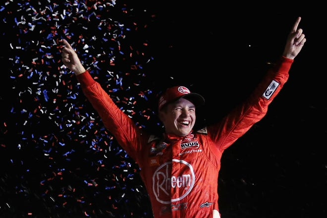Christopher Bell, driver of the #20 Rheem Toyota, celebrates in Victory Lane after winning during the NASCAR Xfinity Series Alsco 300 at Kentucky Speedway on July 13, 2018 in Sparta, Kentucky.