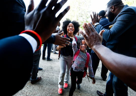 KIPP Memphis Collegiate Elementary students Lisa Taylor, 9, (left) and Lauren Walker, 5, (right) are greeted with high fives on the first day of school. KIPP announced Thursday that KIPP Memphis Preparatory Elementary and Middle will close on June 30. The networks other five schools, including Collegiate Elementary, will remain open. Photo: Mark Weber, The Commercial Appeal