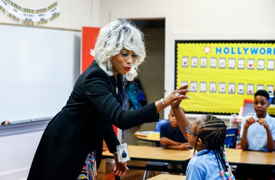 Achievement School District Superintendent Sharon Griffin chats with students at Frayser-Corning Achievement Elementary.