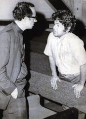 Father James E. Groppi spoke with Jesus Salas, a migrant workers leader, in St. Paul Catholic Church in Madison Oct. 2, 1969, shortly before his arrest. Groppi had taken sanctuary in the church on the University of Wisconsin campus earlier in the day.