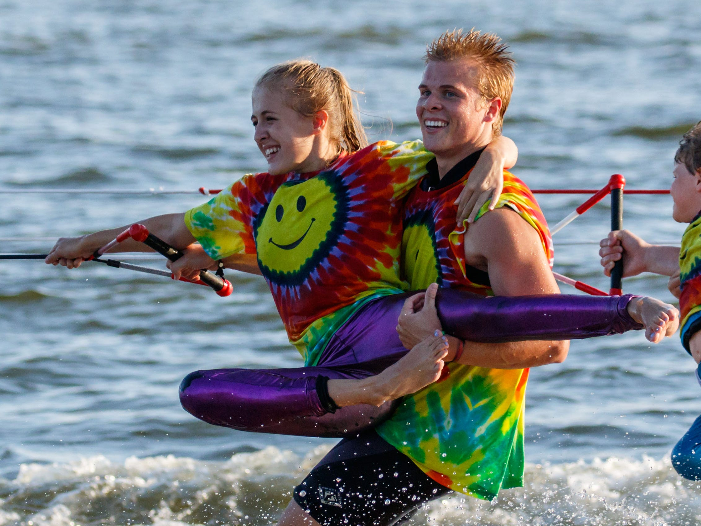 Abby Sinitz of Pewaukee and Jake Moeller of Muskego perform a doubles routine during the Pewaukee Lake Water Ski Club's weekly show at Lakefront Park on Thursday, August 2, 2018.