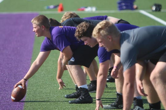 Leif Engstrand (far right) lines up as the Oconomowoc offensive line drills during a practice on August 1.