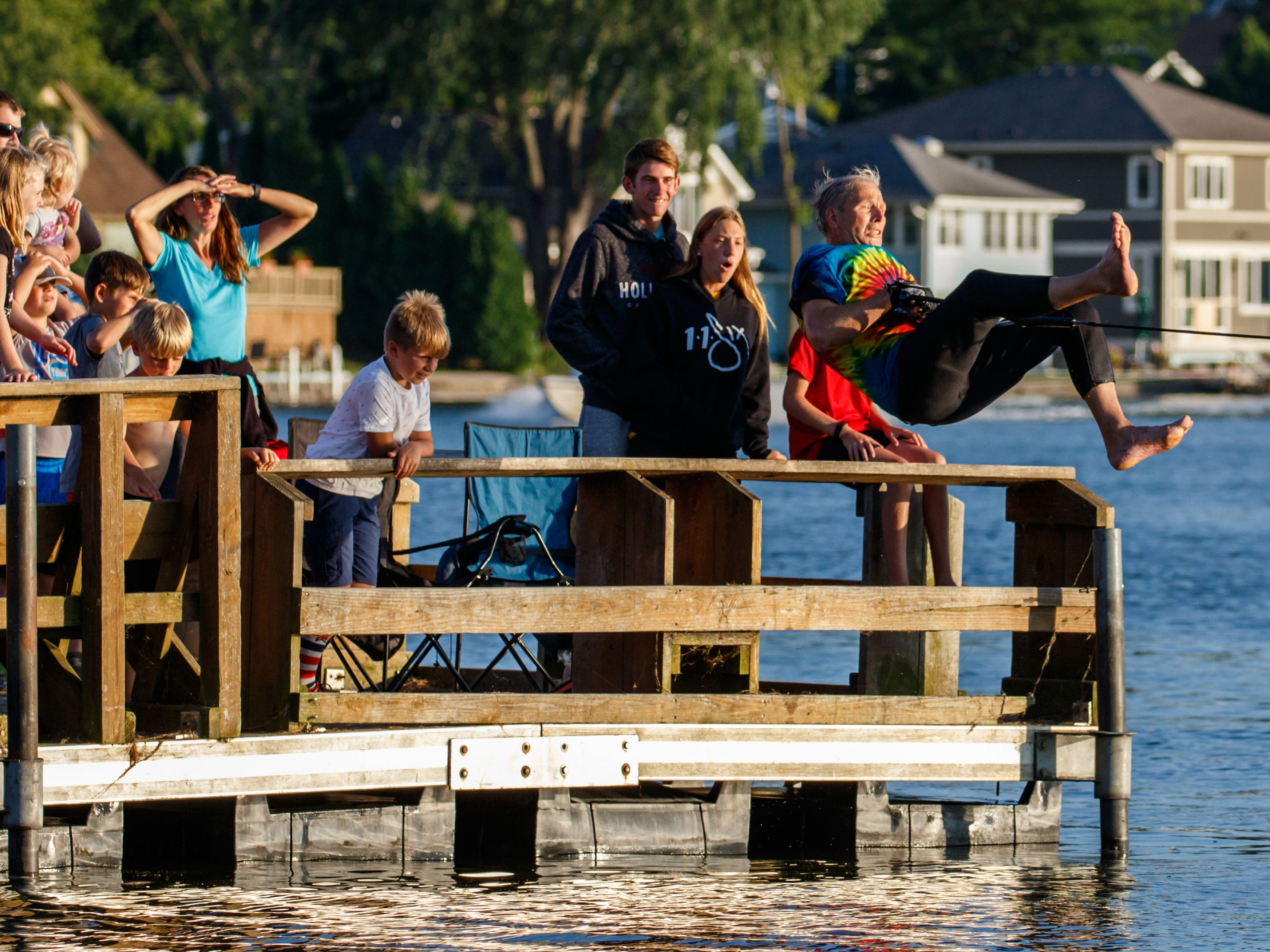 Barefoot skier Mike Rotar of Pewaukee amazes spectators as he launches off the community pier during the Pewaukee Lake Water Ski Club's weekly show at Lakefront Park on Thursday, August 2, 2018.