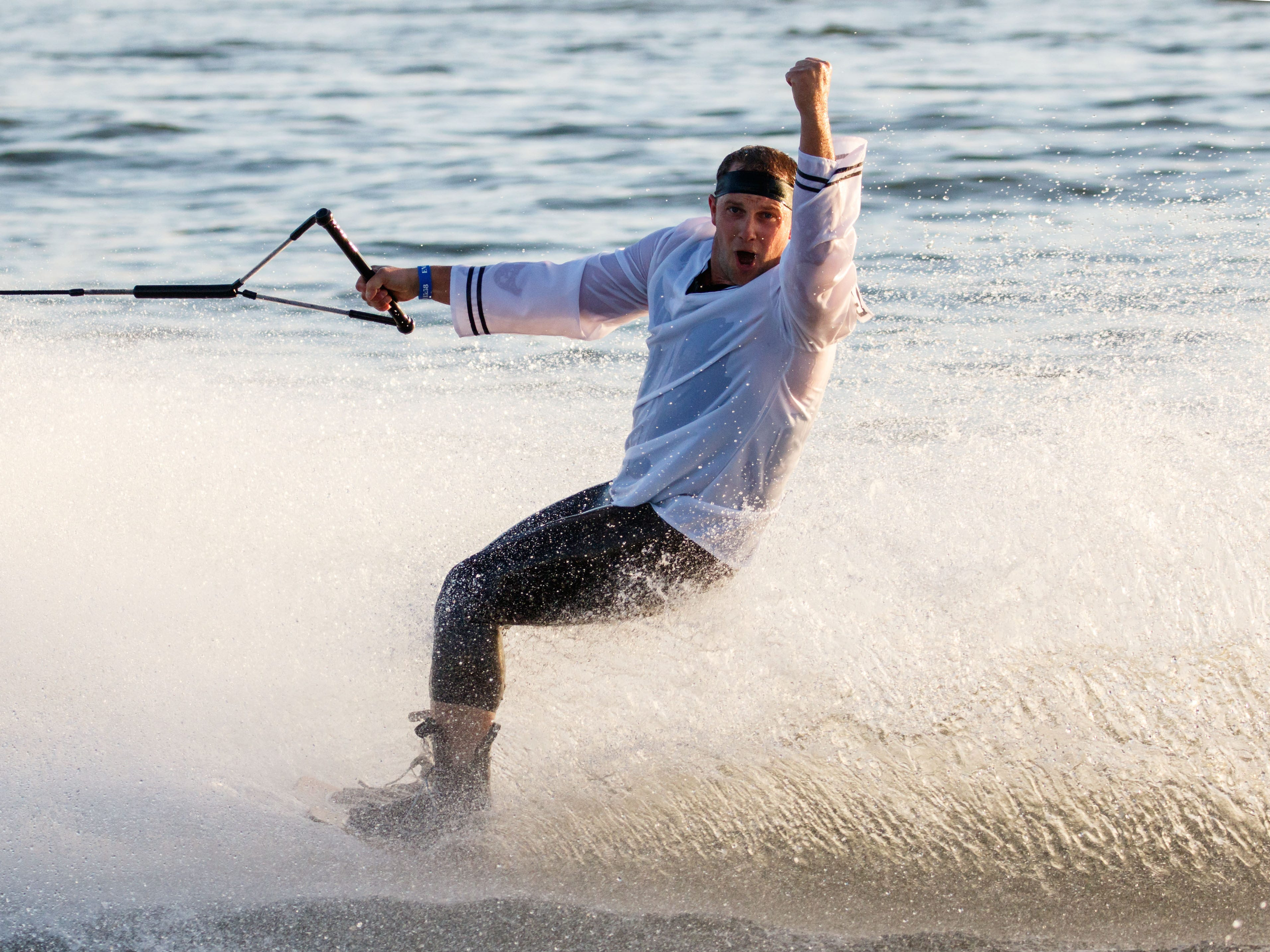 Jon Mohr of Hales Corners fires up the audience during the Pewaukee Lake Water Ski Club's weekly show at Lakefront Park on Thursday, August 2, 2018. The free shows run through Sept. 3. For more info visit plwsc.org.
