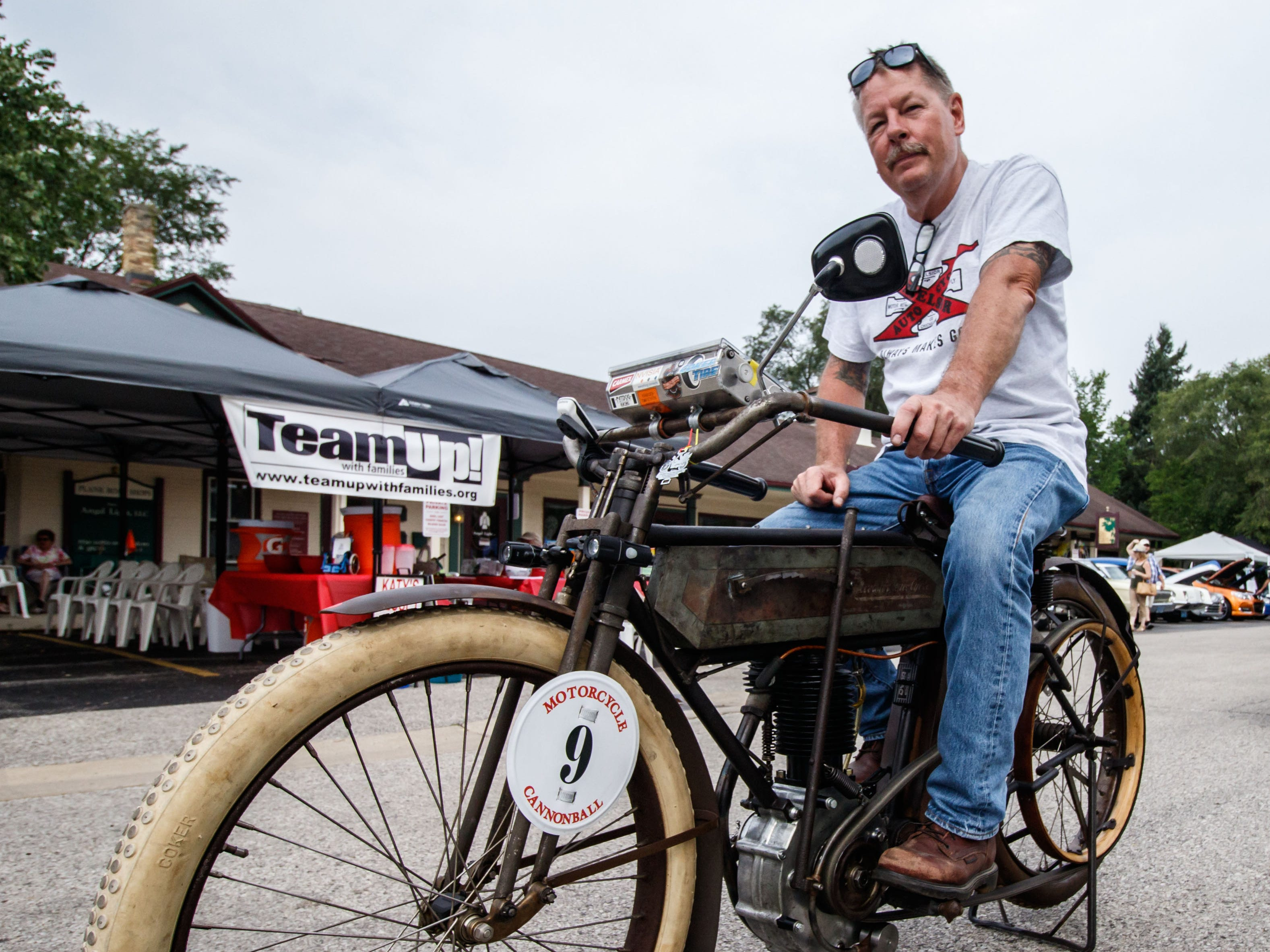 Chris Tribbey of Caledonia displays his 1911 Excelsior Model K Single motorcycle during the 6th annual Cruisin' the Grove street car and motorcycle show in downtown Elm Grove on Sunday, August 5, 2018. Tribbey will attempt to ride the 4 HP motorcycle more than 3,200 miles this fall in the Cannonball Endurance Event.