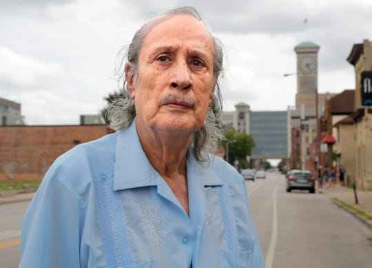Ernesto Chacon stands just off of National Avenue near the Rockwell Automation clock tower, formerly Allen-Bradley Co. Chacon helped organize  a workers' rights march that took place in the area in August 1968. Photo by Mike De Sisti / Milwaukee Journal Sentinel