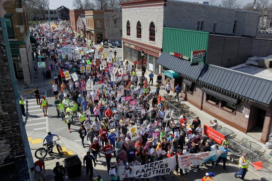 "Thousands of demonstrators marched the streets of Waukesha in May to protest plans by the Waukesha County Sheriff""s Office to participate in a plan that grants it authority to enforce immigration laws.   The demonstrators were organized Voces de la Frontera."
