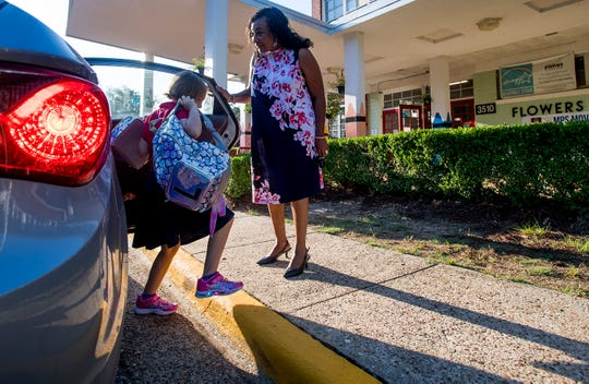 Montgomery School Superintendent Ann Roy Moore greets Flowers Elementary School students as they arrive for the first day of classes at Montgomery Public Schools in Montgomery, Ala., on Monday, August 6, 2018.