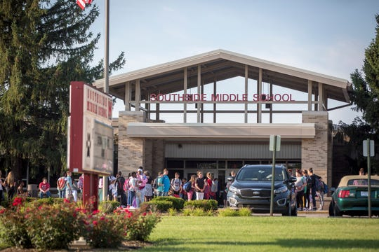 Students walk into Southside Middle School on Aug. 6, 2018, for the first day of school in the Muncie Community School district. Ball State President Geoffrey S. Mearns and Charlie Cardinal greeted many students at the entrance.