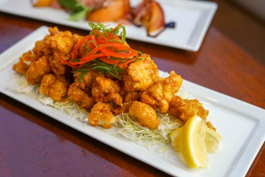 The Pearl's Firetail Gator appetizer is lightly fried and tossed in a Firetail aioli.