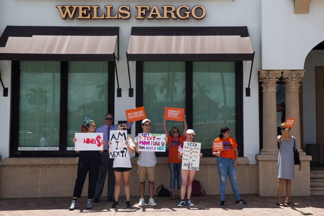 Collier student activists peacefully protest outside of Wells Fargo on Fifth Avenue South against the business the bank conducts with gun makers and the NRA on Monday, Aug. 6, 2018.