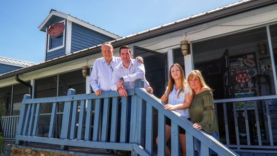The Miller family, photographed last month outside their former Oyster House restaurant in Everglades City, includes, from left, Robert, James, Jillian and Patricia. The Millers recently launched The Pearl Steak & Seafood Restaurant in North Naples.