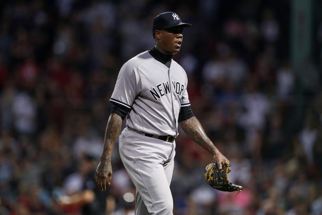 Yankees relief pitcher Aroldis Chapman (54) reacts after giving up the tying run during the ninth inning against the Boston Red Sox at Fenway Park. Mandatory Credit: Paul Rutherford-USA TODAY Sports