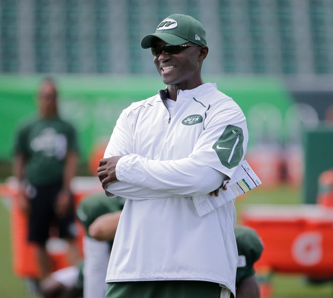 New York Jets head coach Todd Bowles looks over the field during practice at the NFL football team's training camp in Florham Park, N.J., Monday, Aug. 6, 2018. (AP Photo/Seth Wenig)