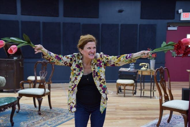 "Madame Arcati (played by Tina Stafford) wards off the evil spirits in the rehearsal of a scene from ""Blithe Spirit.""  Noel Coward's supernatural comedy about a man haunted by the ghost of his first wife runs August 15 through September 2 at Shakespeare Theatre of NJ in Madison."