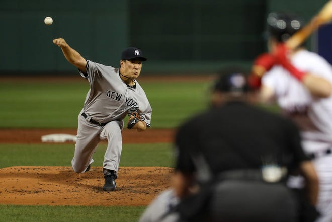 New York Yankees starting pitcher Masahiro Tanaka (19) pitches during the first inning against the Boston Red Sox at Fenway Park.