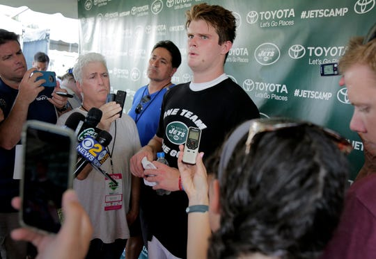New York Jets quarterback Sam Darnold talks to reporters after a practice at the NFL football team's training camp in Florham Park, N.J., Monday, Aug. 6, 2018. (AP Photo/Seth Wenig)