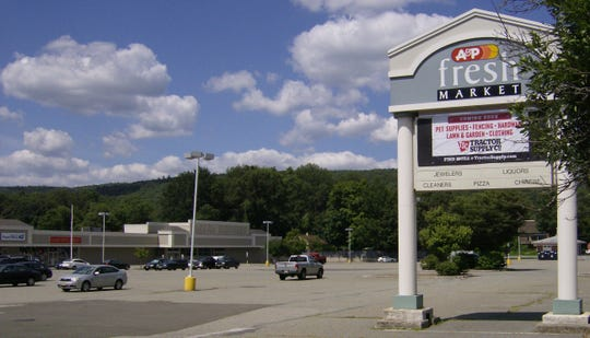 A banner hangs at the West Milford Shooping Plaza announcing the pending opening of a Tractor Supply Company retail store in West Milford, N.J.'s Hewitt section.