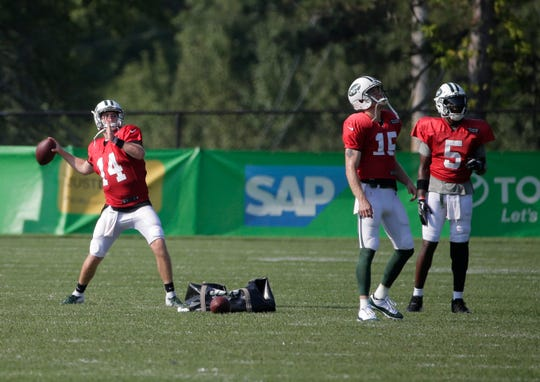 New York Jets quarterbacks Sam Darnold, left, Josh McCown, center, and Teddy Bridgewater throw footballs after a practice at the NFL football team's training camp in Florham Park, N.J., Monday, Aug. 6, 2018. (AP Photo/Seth Wenig)