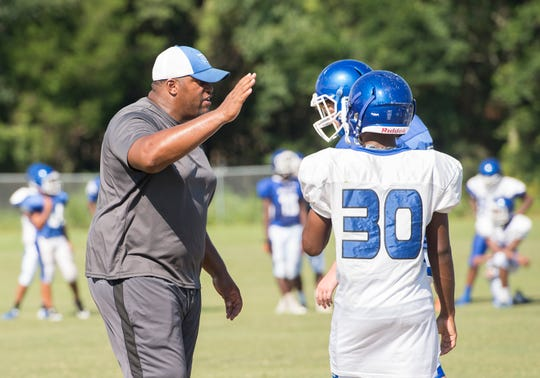 New head coach Dredrick Bell gives instructions to his players during football practice at Booker T. Washington High School in Pensacola on Monday, August 6, 2018.