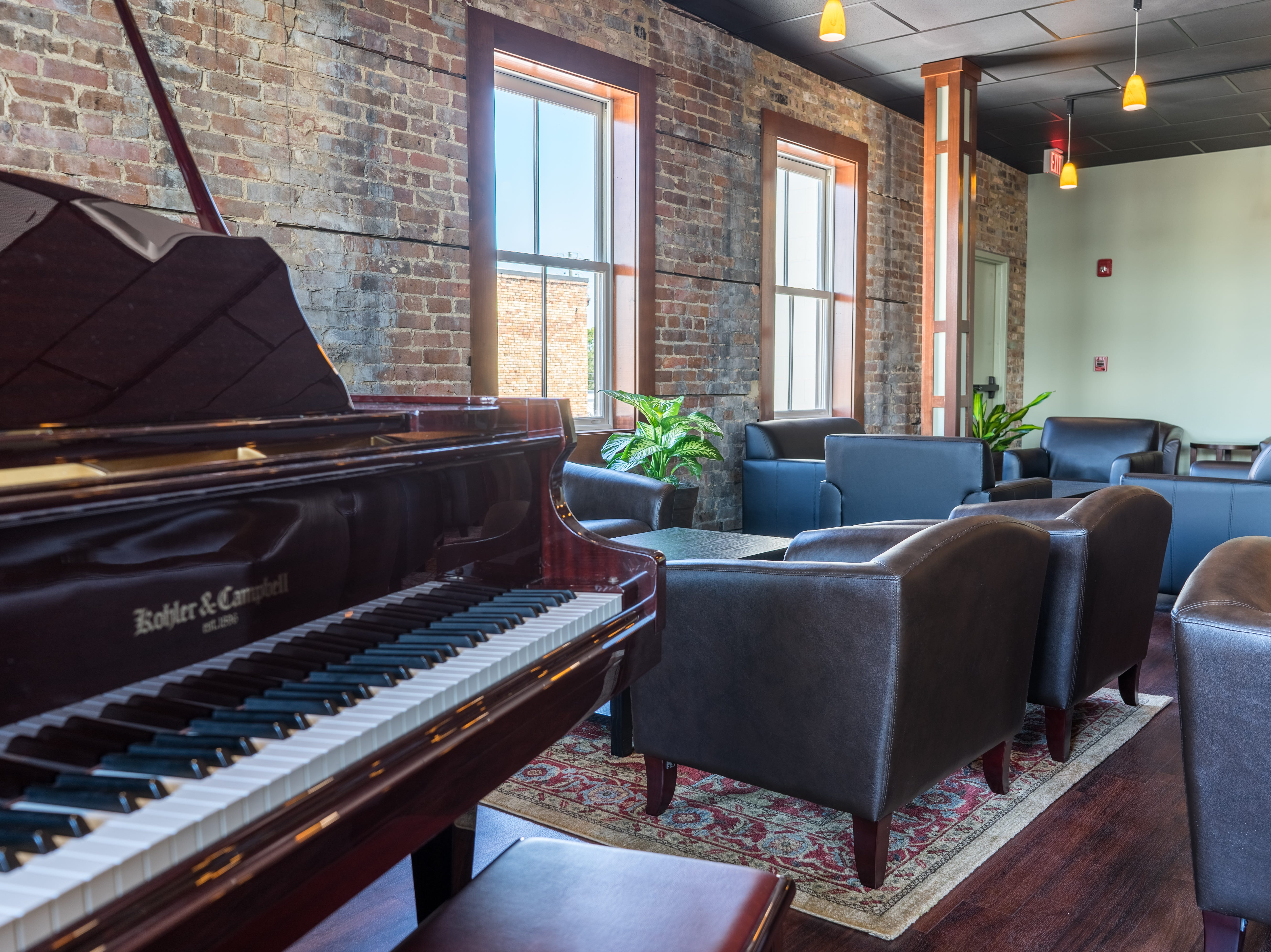 The District's upstairs lounge is filled with leather lounge chairs, love seats, couches and cocktail-height tables.