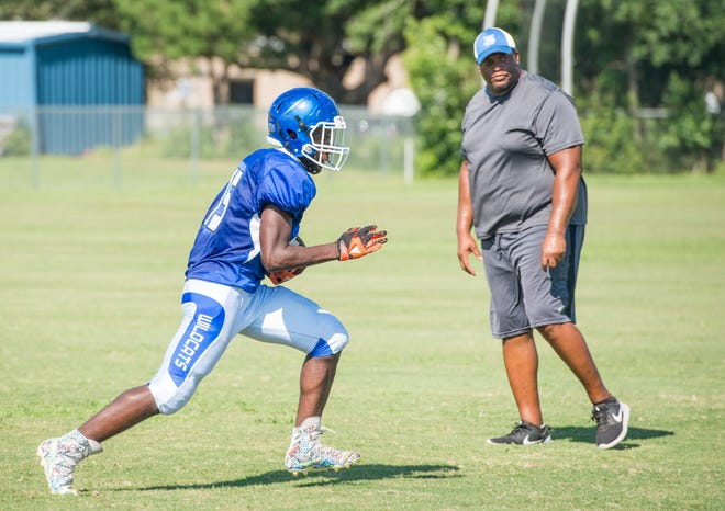 New head coach Dredrick Bell keeps an eye on progress during football practice at Booker T. Washington High School in Pensacola on Monday, August 6, 2018.