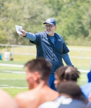 Head coach Pete Shinnick gives instructions to his players during the first day of 2018 preseason football practice at the University of West Florida in Pensacola on Monday, August 6, 2018.