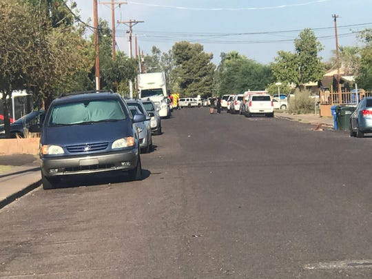 The scene near 23rd and Glenrosa avenues following an officer-involved shooting. No officers were injured, but the suspect was wounded.