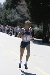 In this file photo from April 21, 1980, American runner Bill Rodgers competes in the Boston Marathon. Rogers went on to win the event for the fourth time.