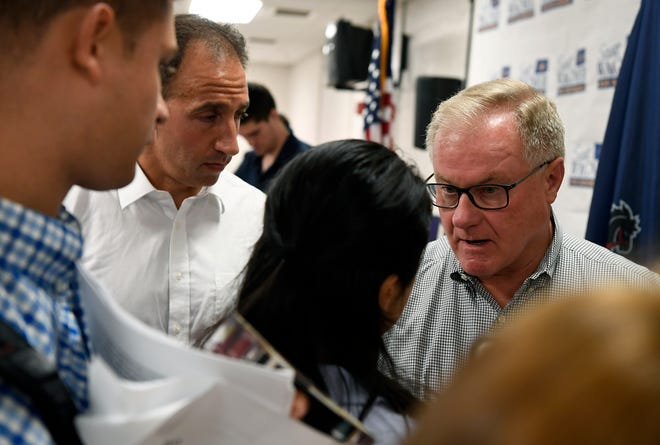 Republican candidate for governor Scott Wagner exchanges words with Lisa Grimm, a volunteer from the Sunrise Movement, following a town hall event at the Shiloh Fire Hall, Sunday, August 5, 2018. John A. Pavoncello photo