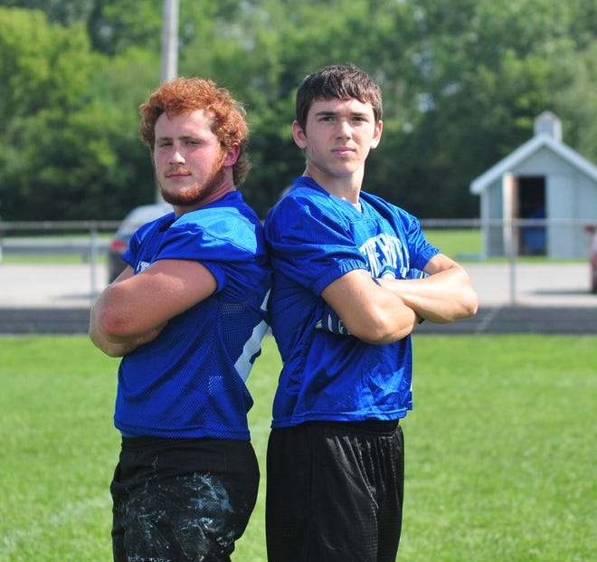Centerville football players Chris Pritchett, left, and Dylan Benedict