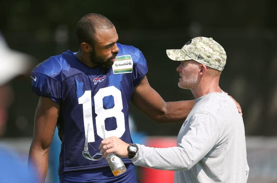 Bills receiver Andre Holmes speaks with head coach Sean McDermott after a training camp practice.