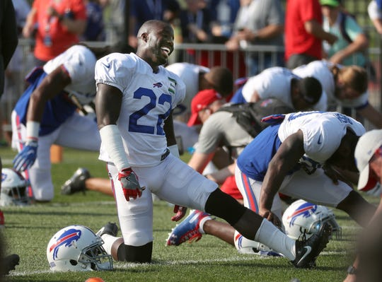 Bills cornerback Vontae Davis  shares a laugh while stretching before practice.
