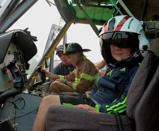 Carter and Kenny Garrison got to sit in the cockpit of a helicopter Monday.